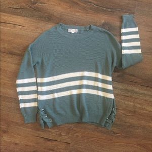 Striped sweater with tied sides.  Size Medium